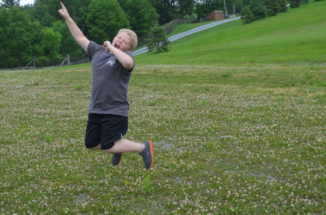 My son jumping at the site of original Woodstock stage