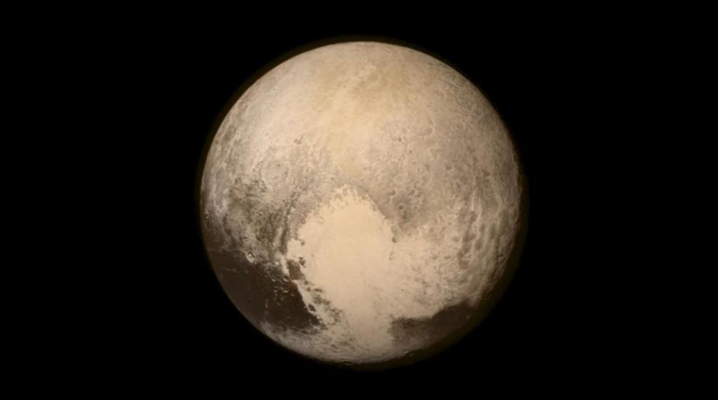 """Pluto nearly fills the frame in this image from the Long Range Reconnaissance Imager (LORRI) aboard NASA's New Horizons spacecraft, taken on July 13, 2015, when the spacecraft was 476,000 miles (768,000 kilometers) from the surface and released on July 14, 2015. More than nine years after its launch, the U.S. spacecraft sailed past Pluto on Tuesday, capping a 3 billion mile (4.88 billion km) journey to the solar system's farthest reaches, NASA said. This is the last and most detailed image sent to Earth before the spacecraft's closest approach to Pluto on July 14. The color image has been combined with lower-resolution color information from the Ralph instrument that was acquired earlier on July 13. This view is dominated by the large, bright feature informally named the """"heart"""" which measures approximately 1,000 miles (1,600 kilometers) across. The heart borders darker equatorial terrains, and the mottled terrain to its east (right) are complex. However, even at this resolution, much of the heart's interior appears remarkably featureless - possibly a sign of ongoing geologic processes.     REUTERS/NASA/APL/SwRI/Handout  ATTENTION EDITORS - FOR EDITORIAL USE ONLY. NOT FOR SALE FOR MARKETING OR ADVERTISING CAMPAIGNS. THIS IMAGE HAS BEEN SUPPLIED BY A THIRD PARTY. IT IS DISTRIBUTED, EXACTLY AS RECEIVED BY REUTERS, AS A SERVICE TO CLIENTS"""
